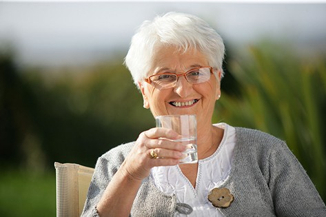 bigstock-Senior-woman-with-a-glass-of-w-44770198